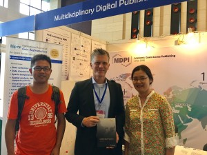 Prof. Zipf (middle) and Dr. Fan (left) at MDPI booth. Prof. Zipf obtains paper collection from MDPI.