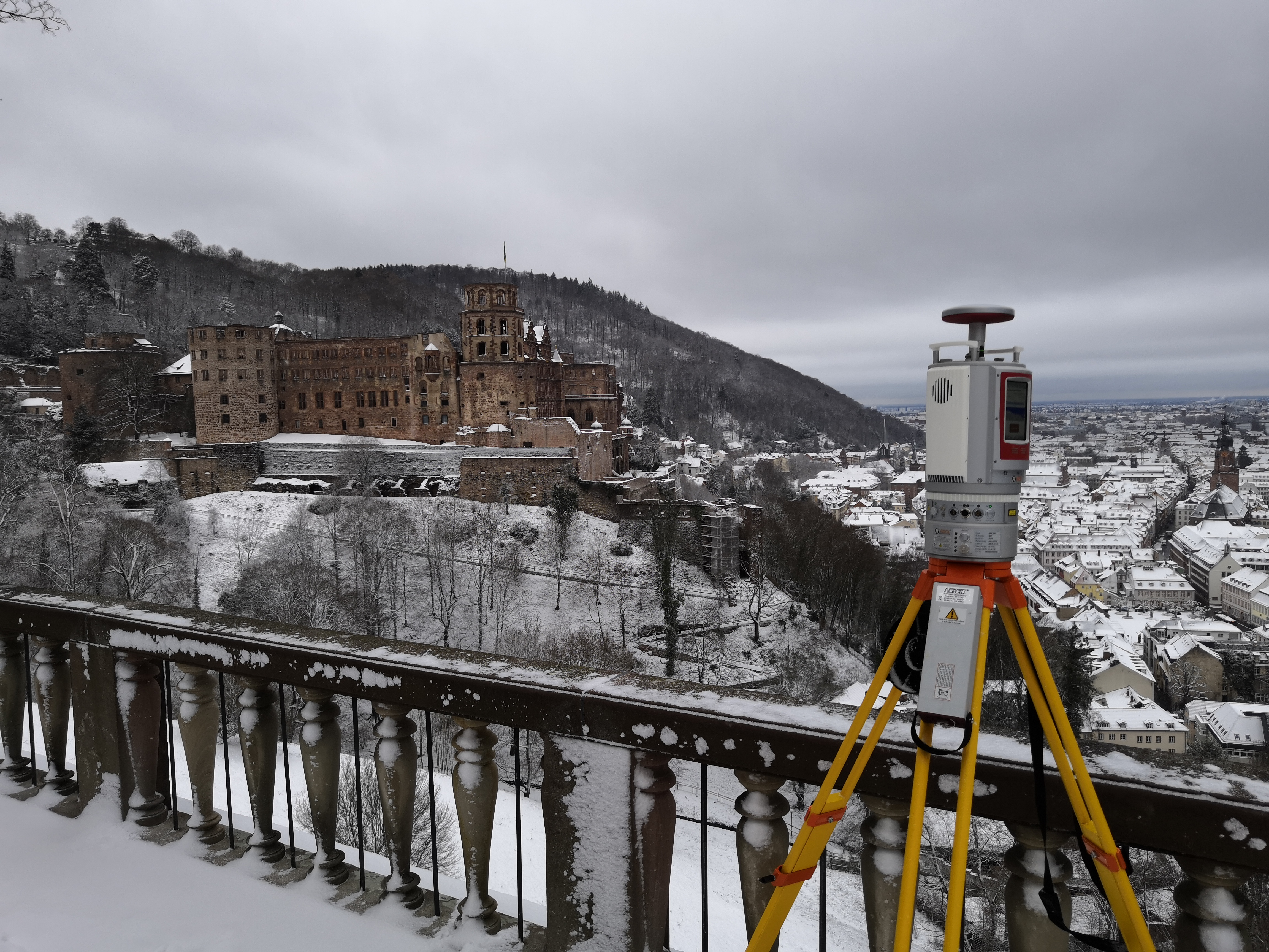 Geodata acquisition with a Riegl VZ-2000i terrestrial laser scanner. Heidelberg castle is in the background.