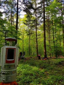 Terrestrial laser scanning in a green and beautiful forest environment.